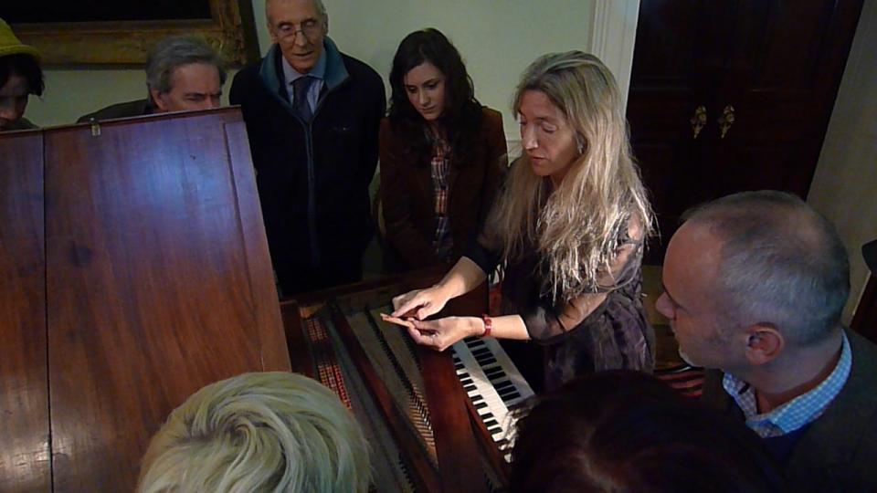 Jane Chapman shows the harpsichord at Tatton Park