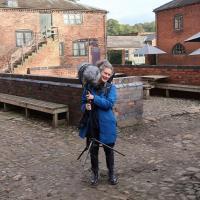 Sound artist Dr Brona Martin in the Erddig stable yard